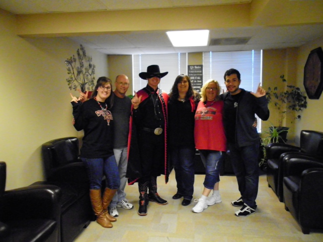SDS counselors pose for a photo with the Masked Rider